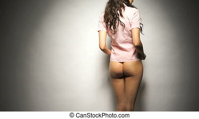 Sexy woman in panties and shirt - Back view of beautiful and...