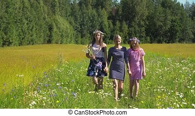 Girl walking on the field. - Mother and daughters walks the...
