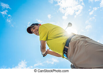 Low-angle view of a professional player holding the club...