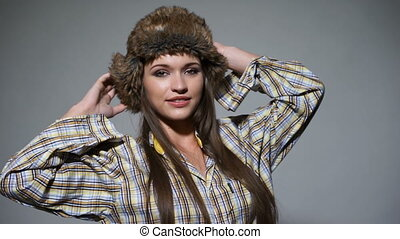 Pretty woman in fur hat