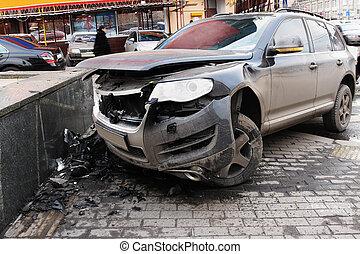 crashed car - The image of crashed car stands on a sidewalk
