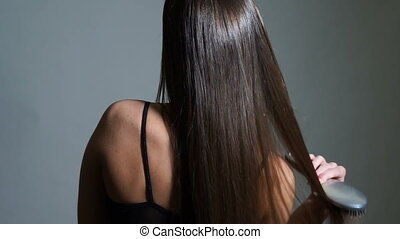 Back of brunette woman with beautiful hair - Back view...