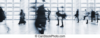 crowds of business people in motion blur - Abstract blurred...