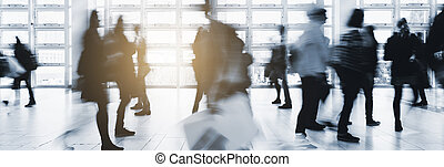 Anonymous crowd in a modern hall - Abstract blurred...