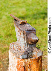 Hammer on the portable anvil. Old fashioned blacksmith tools...