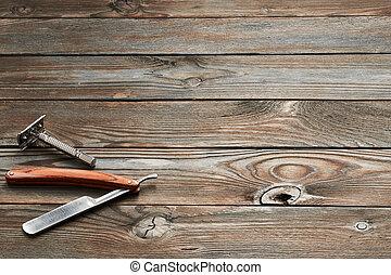 Vintage barber shop razor tools on wooden background -...