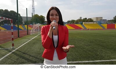 Young girl TV reporter is broadcasting