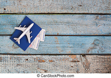 airplane on a passport with air tickets, close-up, on a wooden background