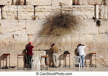 At the Wailing Wall - Three men at the Wailing wall in...
