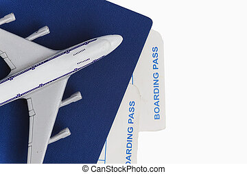 airplane on passport with air tickets, isolated on white background, close-up