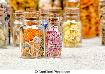 Bottles with herbs used in non- traditional medicine. High...