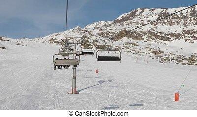 Ski lift ascend - Using ski lift in the Alps