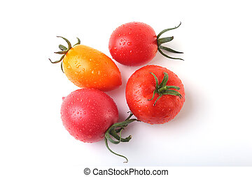 assorted fresh tomatoes with green leaves isolated on white...