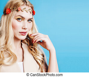 young blond woman dressed like ancient greek godess, gold...