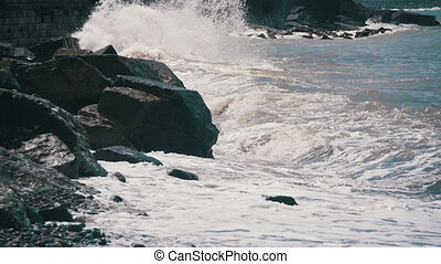 Big Waves Crashing on Stone Beach. Slow Motion in 96 fps....