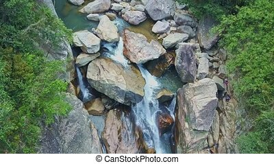 Amazing Aerial View River Running between Large Rocks -...