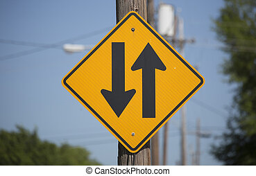 Two-Way Traffic Sign - Close up of a two-way traffic sign on...