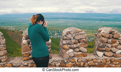 Woman Photographing Landscape. View from an Ancient Fortress...