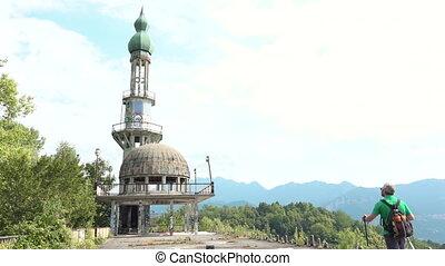 Tourist walking at abandoned minaret Arabian style,...