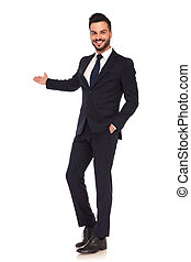 happy modern young business man presenting and smiling on...