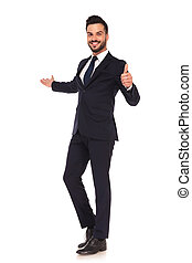 young business man presenting and making the ok hand sign -...