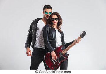 cool rock and roll couple with electric guitar