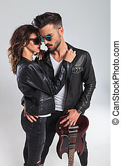 in love rock and roll couple with electric guitar