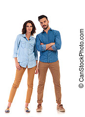full body picture of a serious casual couple