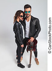 hot rock and roll couple in leather jackets and sunglasses