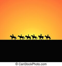 Horse riders silhouettes at sunrise