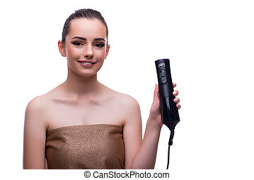 Woman in beauty concept with hair dryer blower drying