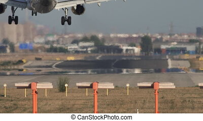 Jet landing, rear view - Rear view of jet landing to runway...