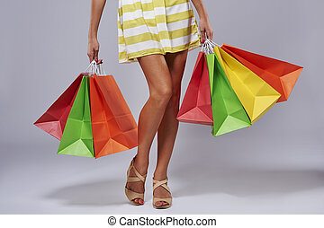 Unrecognizable person with paper shopping bags