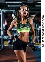 Athletic young sexy fitness woman on diet train and exercising in gym