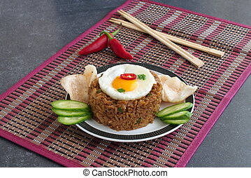 Nasi goreng fried rice with shrimps and egg garnished with...