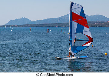 Wind Surfing in the Summer on Calm Coastal Water