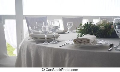 Serving a festive table. - Banquet decorated table, with...