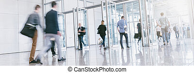 Crowd of people at a entrance - Blurred business commuters...