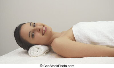 Girl shows her thumb up on the massage table - Cute...