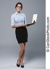 Recent model of laptop presented by an attractive woman