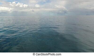 A blue sea's horizon