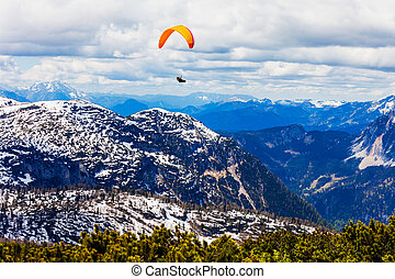 Paraglider in Salzkammergut, Austria - Paraglider in the...
