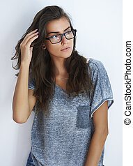 Young woman looking away with her eyewear