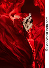 Fashion Model Art Dress, Woman Dancing in Red Waving Fabric, Beautiful Girl on Artistic Cloth background
