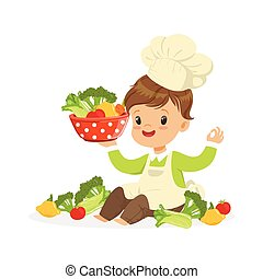 Cute little boy chef cooking fresh vegetables, kids healthy...