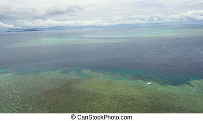 Wide shot of ocean and coral reef under water