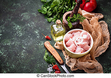 Raw sliced chicken meat ready for cooking. Selective focus