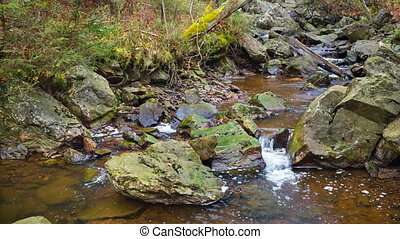 Tro Maret River, Ardennes, Belgium - Small waterfalls of the...