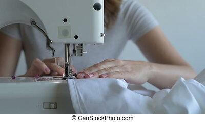 Close up of a woman sewing