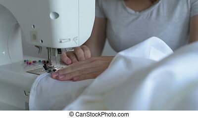 Close up of sewing a white sheet